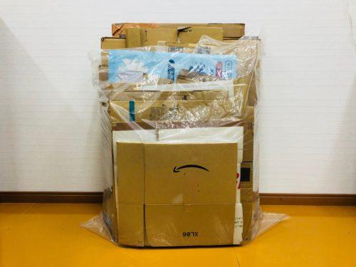 90リットルごみ袋に収納されたダンボール